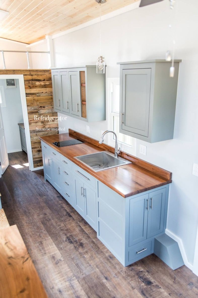 24ft Sip Tiny House On Wheels With Faux Stucco Paint By Cornerstone Tiny Homes Tiny House Kitchen Tiny House Interior Design House On Wheels