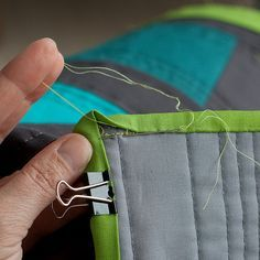how to easily hand sew a quilt binding.  Why didn't I think to use those clips??