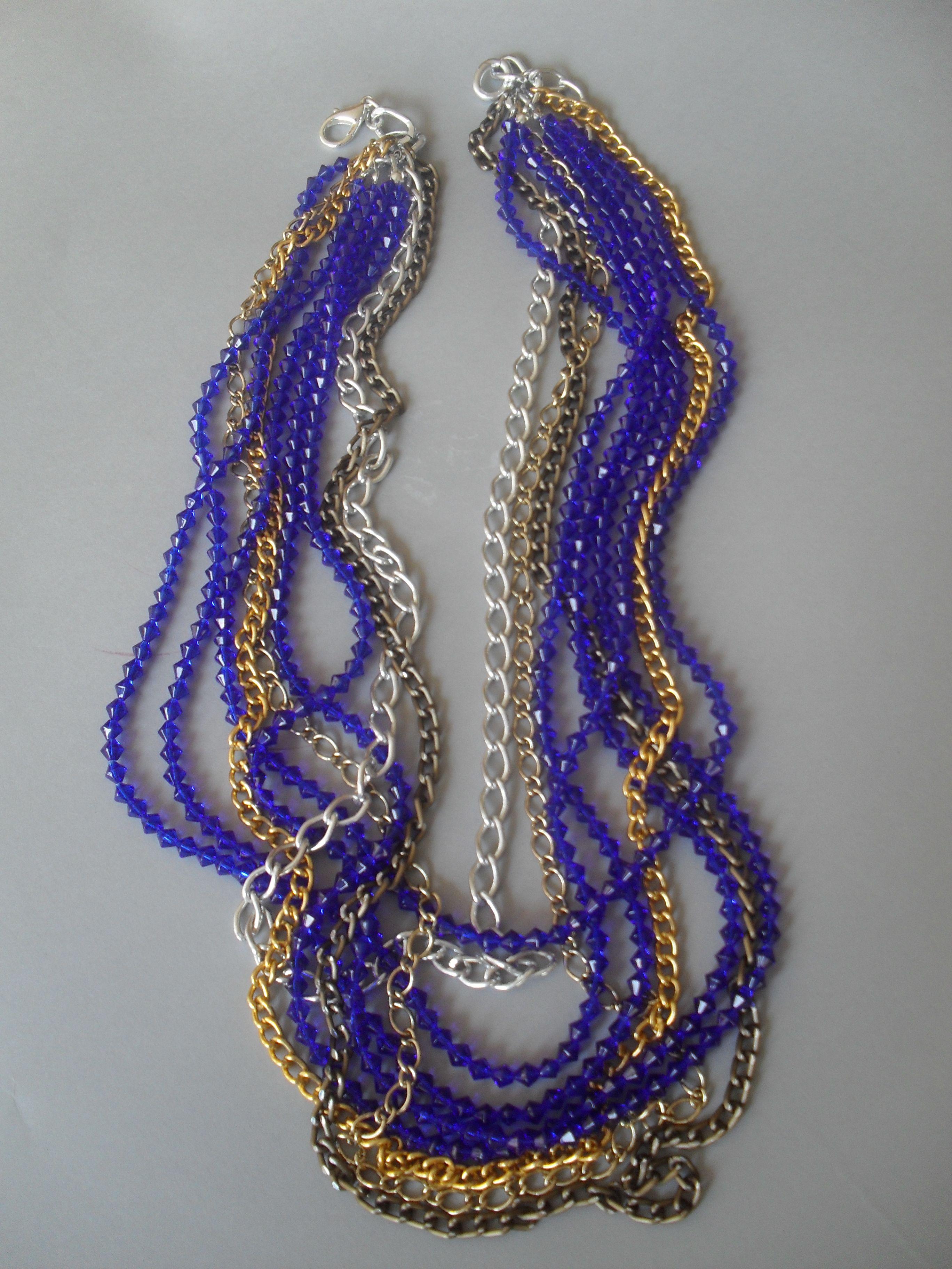 Collar largo de cristales azul cobalto con cadenas en color plata, bronce y dorado