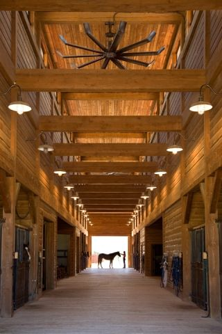 A modern, oversize fan keeps the fresh air circulating inside this Stevensville, Montana barn. I'd love these fans for the indoor arena.
