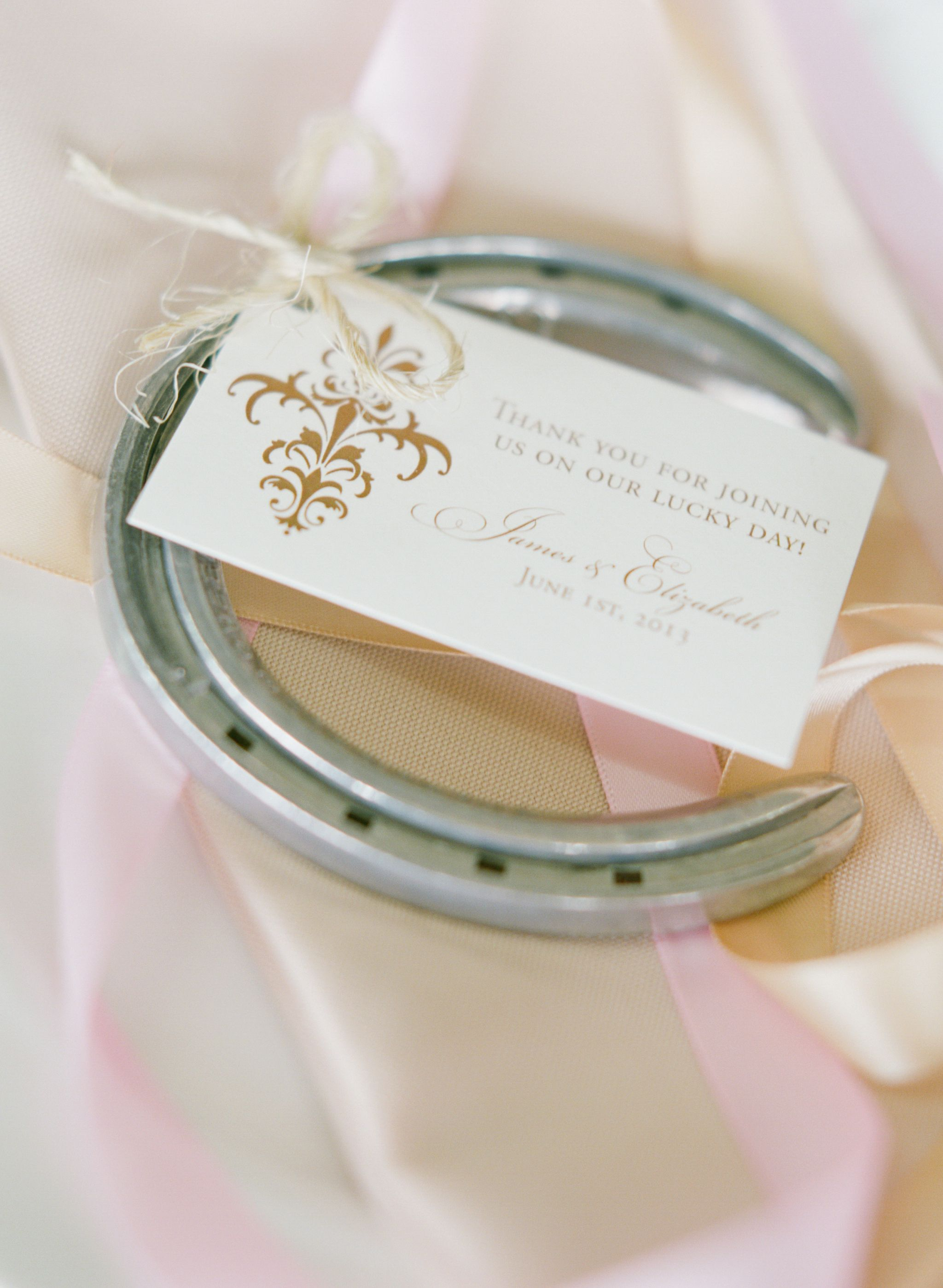Horseshoe wedding favors with a burlap tag with a gold baroque ...