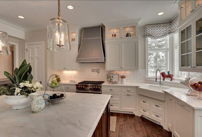 island countertop is honed carrara marble, exteriors are quartz