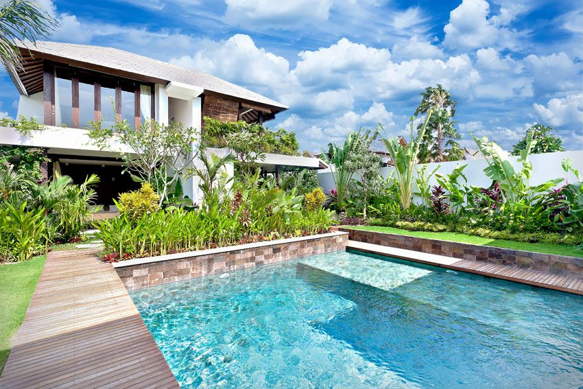 swimming-pool-with-sitting-platform-and-tropical-landscaping ...