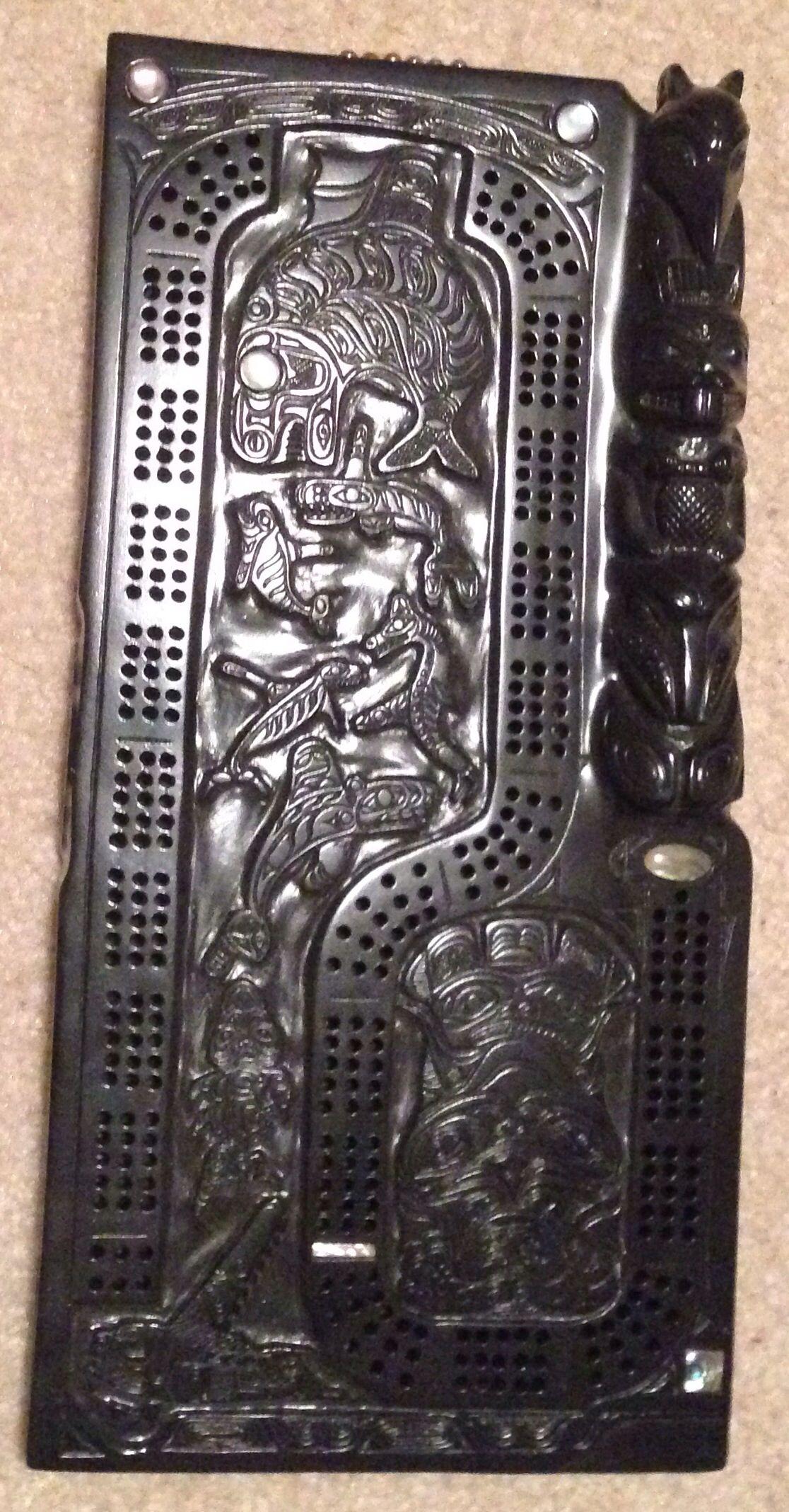 Haida design cribbage board, totem pole and various motifs ...