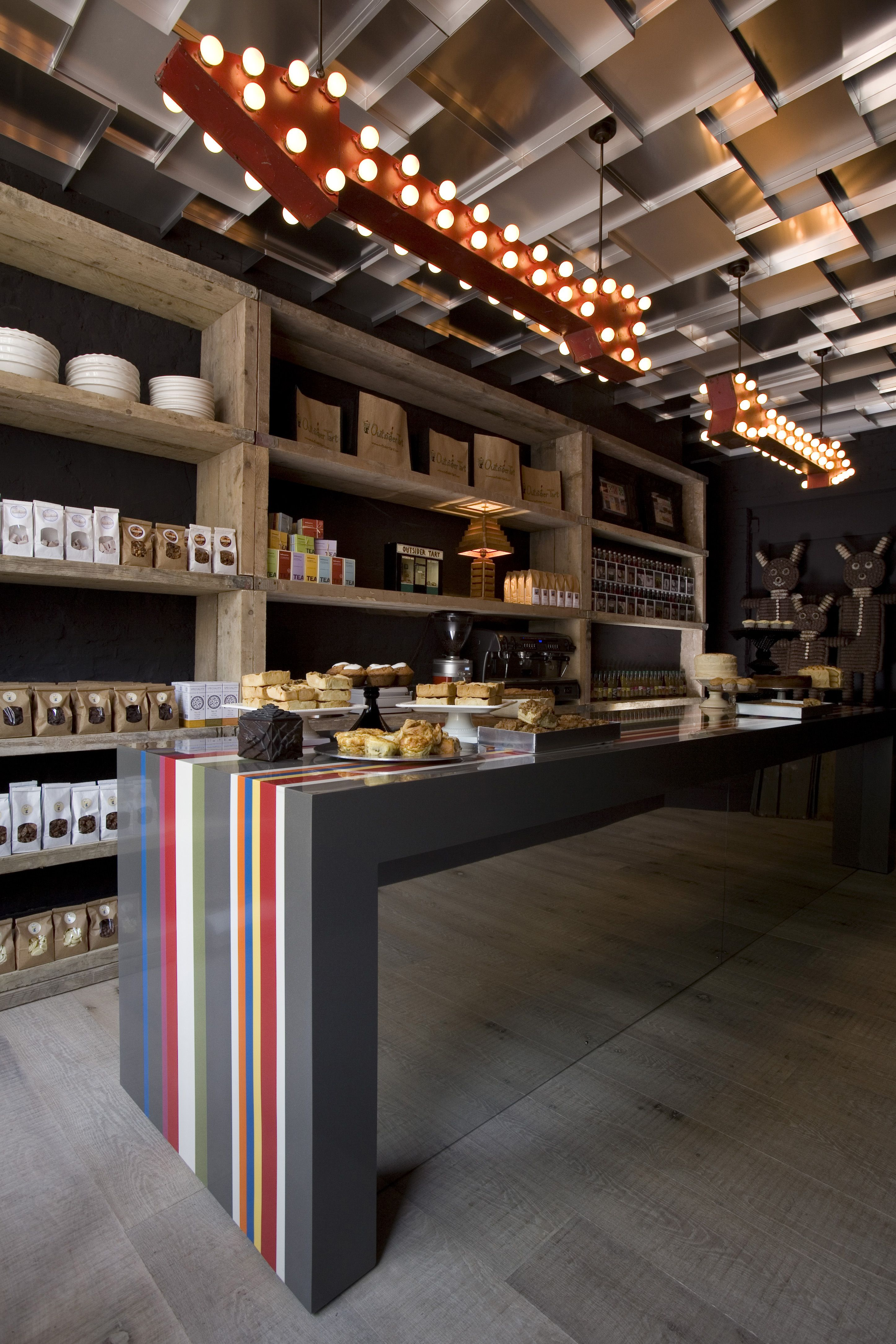 Strurdey shelves modern colour scheme funky lights cafe design store design restaurant design