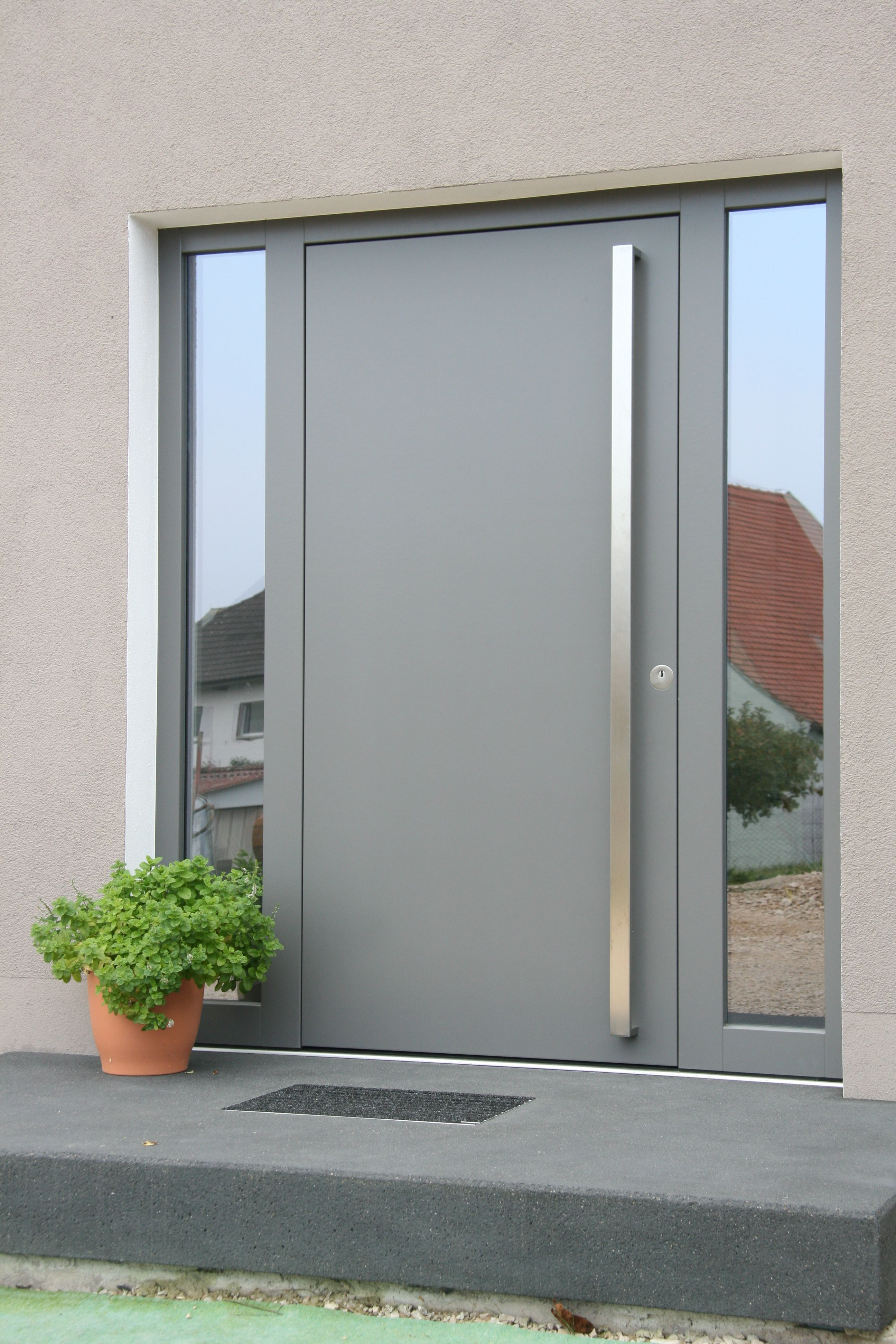 modern front door with side glass windows