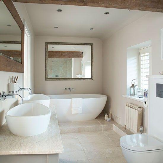 neutral stone tiled bathroom