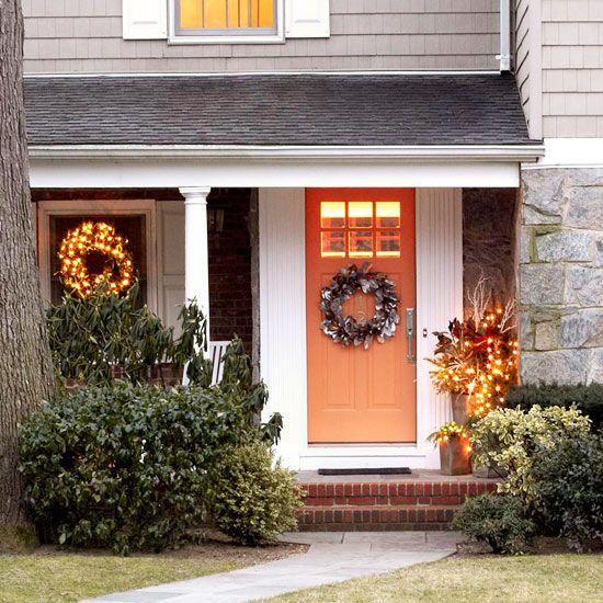 Wrap Your Entry in Lights  Lights are much beloved at holiday time for sparkle and accent as well as general feelings of cheer. Make smart use of strands of mini white lights for Christmas door decorations, using them to dress up wreaths, hang on windows, and brighten a container of interesting foliage on the front porch.