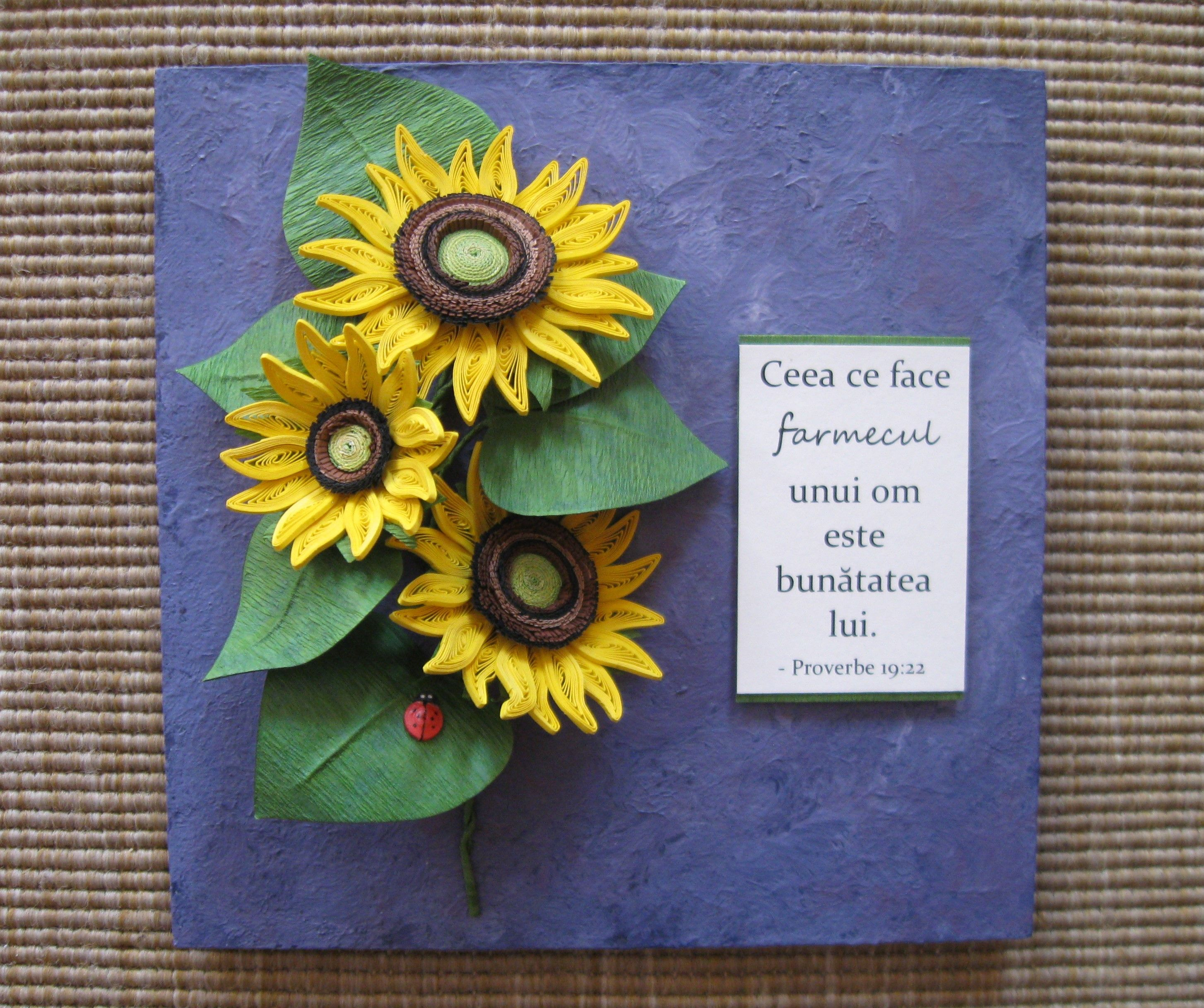 Quilled sunflowers on a blue panel