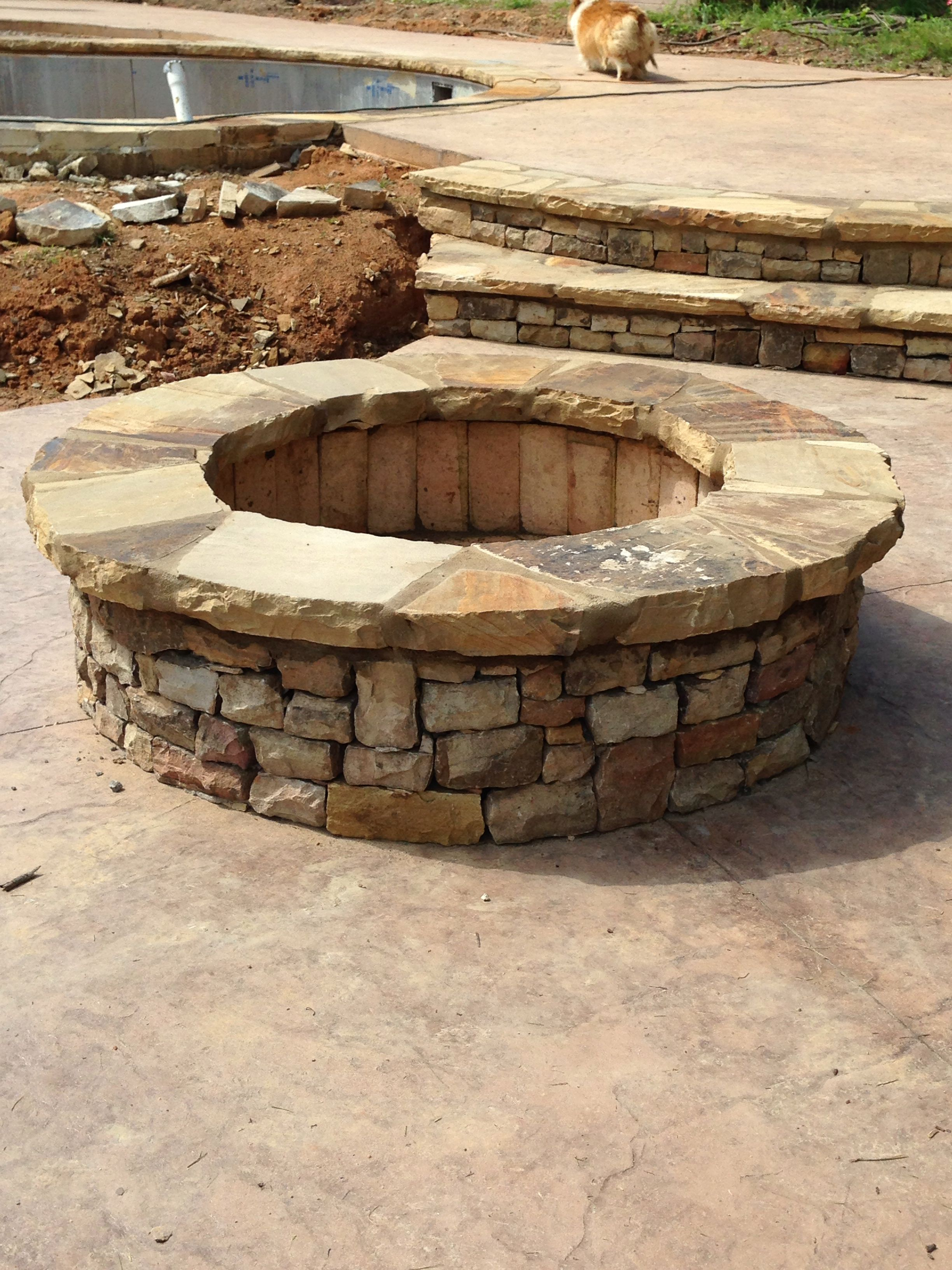 Stacked Fire Pit With Thick Cap Stone And Stamped Concrete Backyard Fire Diy Fire Pit Fire Pit