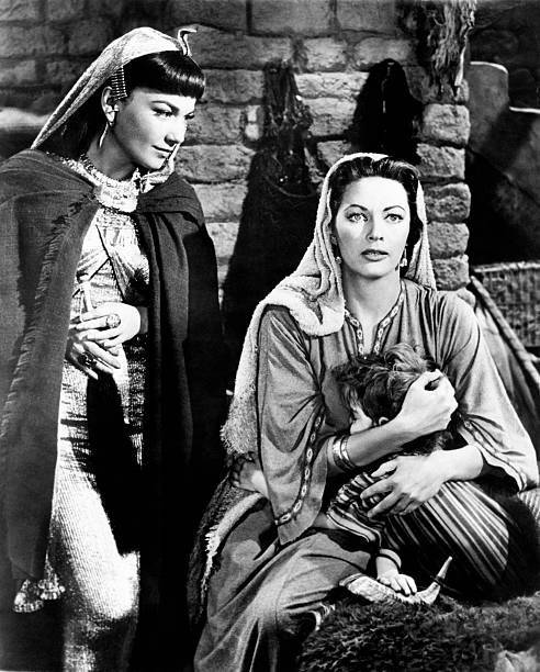 Anne Baxter speaking with Yvonne De Carlo in a scene from the movie...