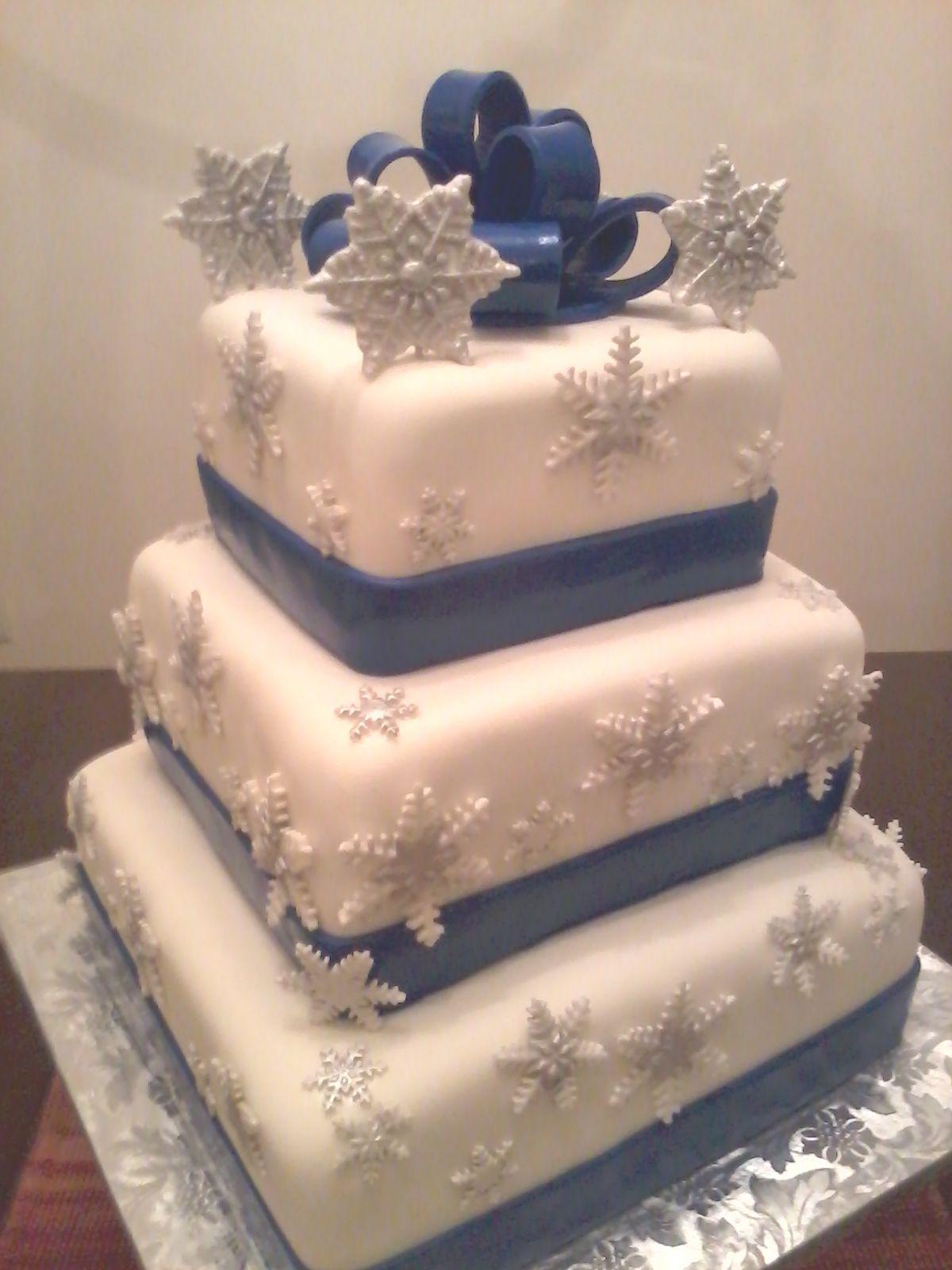 Three tier marshmallow fondant custom cake with sugar paste bow
