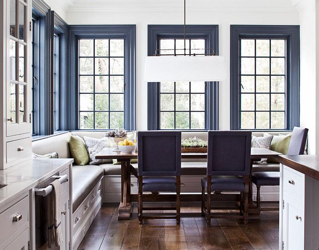 Love this trend in interior design - painted trim in a bold color like this blue trim against a white wall.