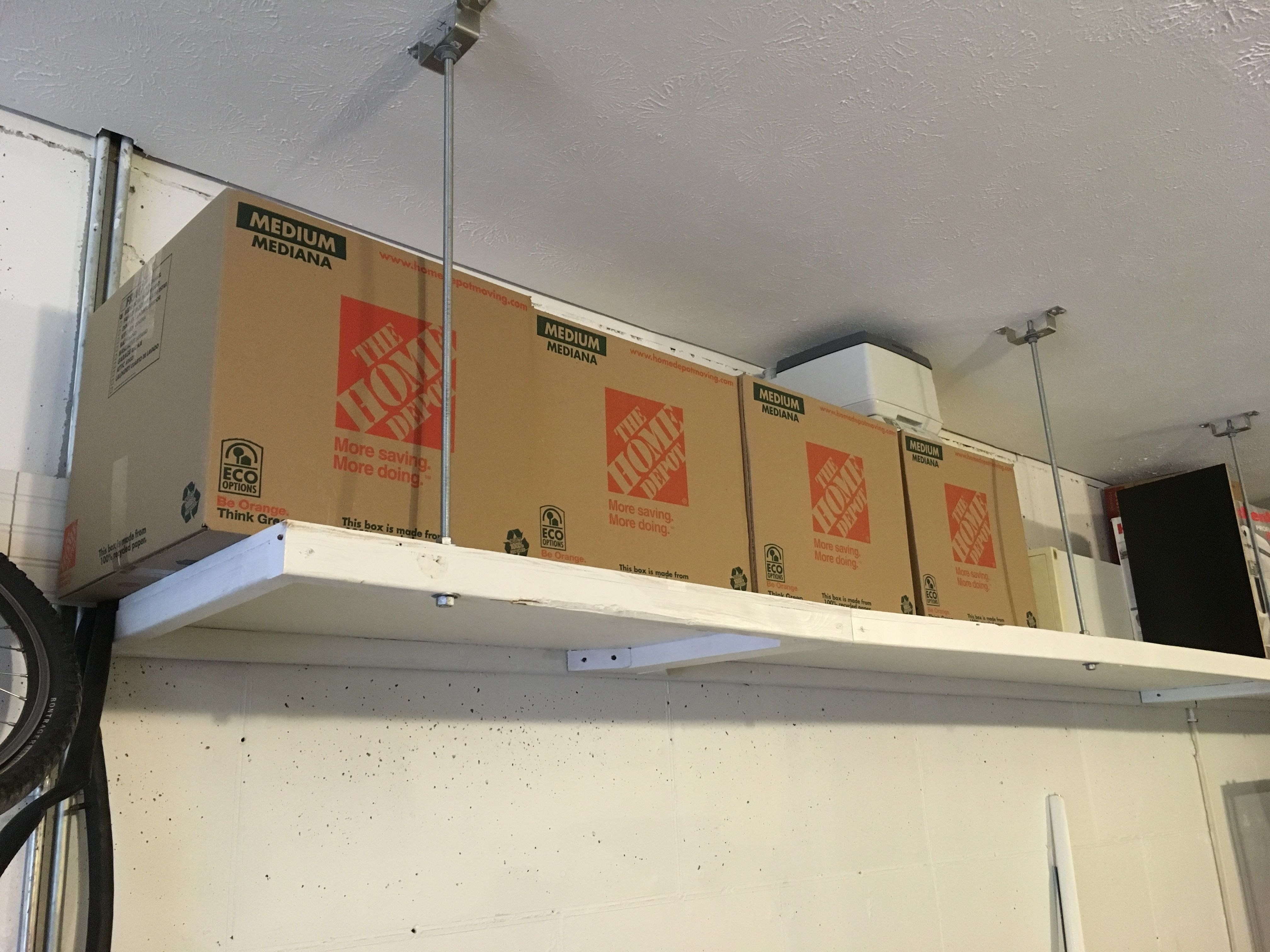 My solution for overhead storage in our garage requiring lagging
