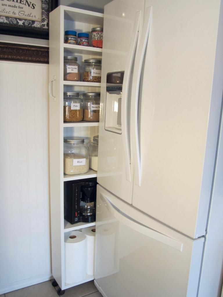 Diy Rolling Pantry Tucks Into Space By Fridge Rolling Pantry Fridge Storage Simple Kitchen Cabinets