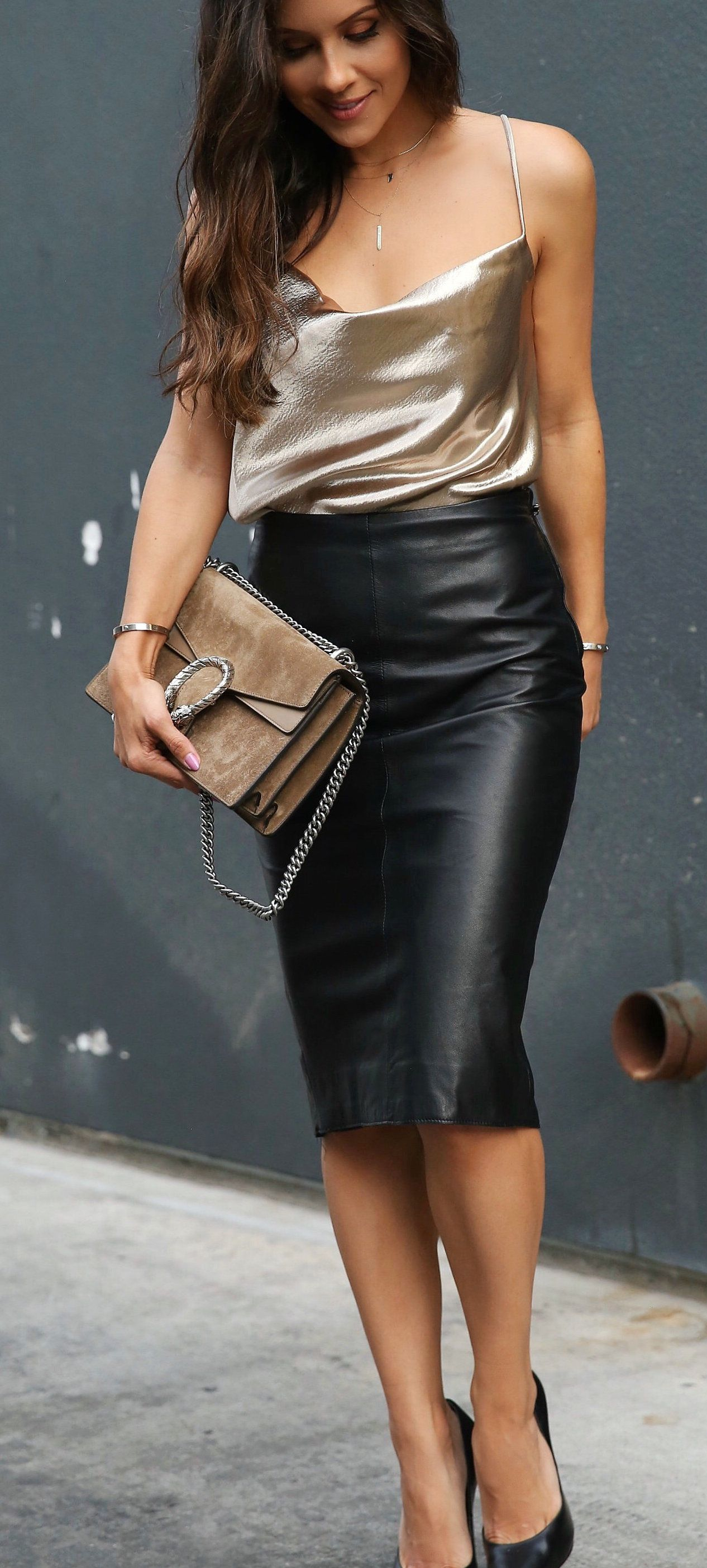 spring #outfits woman wearing black leather skirt holding brown