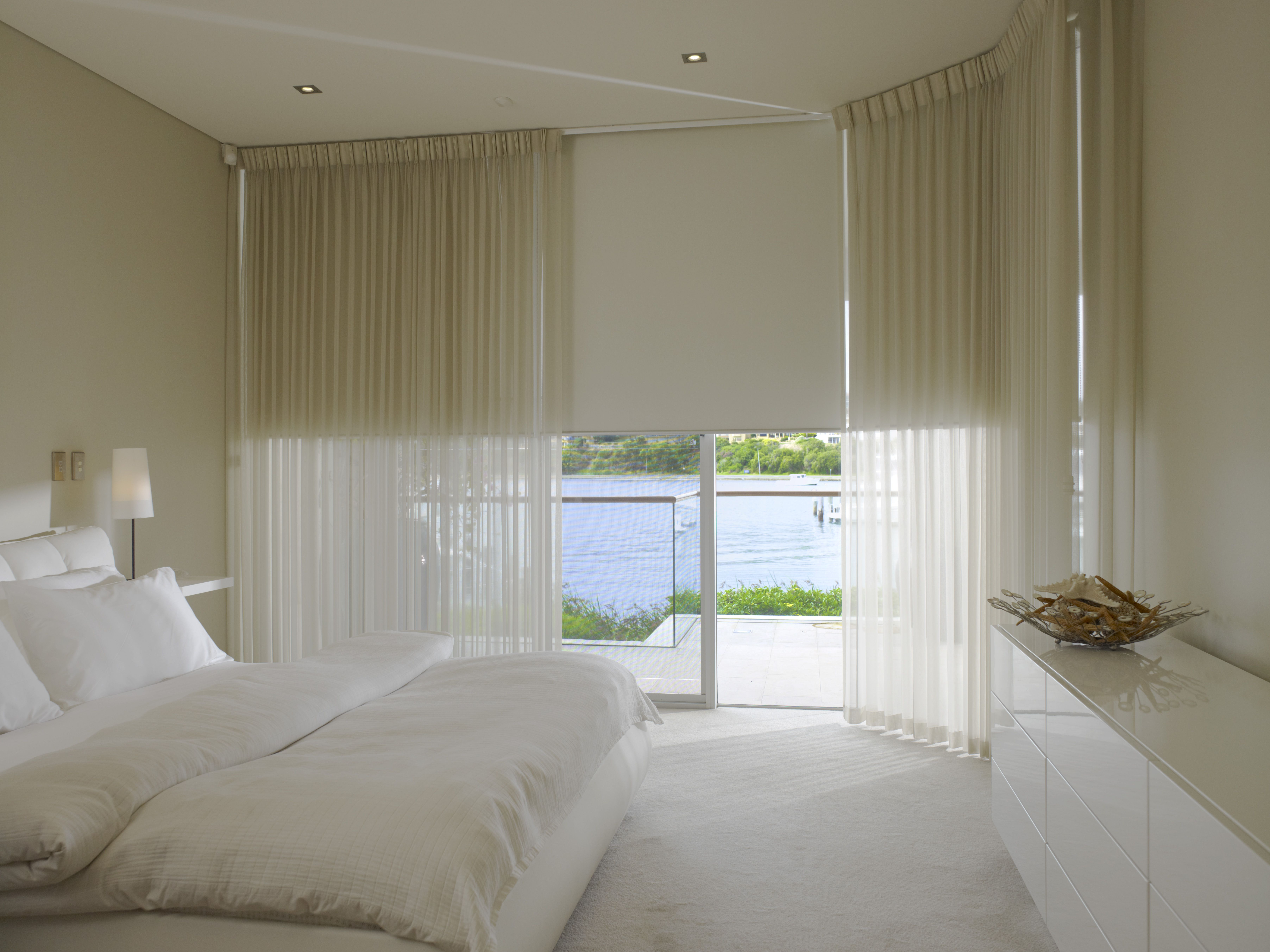 Combining Blinds And Sheer Curtains Can Be Both Elegant