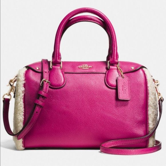 """4th Of July Sale!!COACH Pink Purse Hot pink COACH Purse with white sherpa detail on sides. Gold hardware. Detachable shoulder strap. Pink lining. 9.5"""" long 7.5"""" high 4"""" width.BRAND NEW WITH TAGS!!! Coach Bags Satchels"""