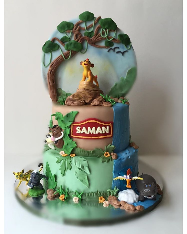 The lion guard birthday cake With disney lion guard figures cake