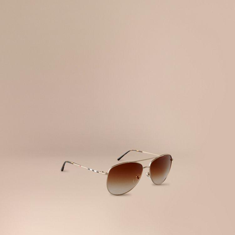 Gafas de sol estilo aviador con patillas a cuadros | moda ...