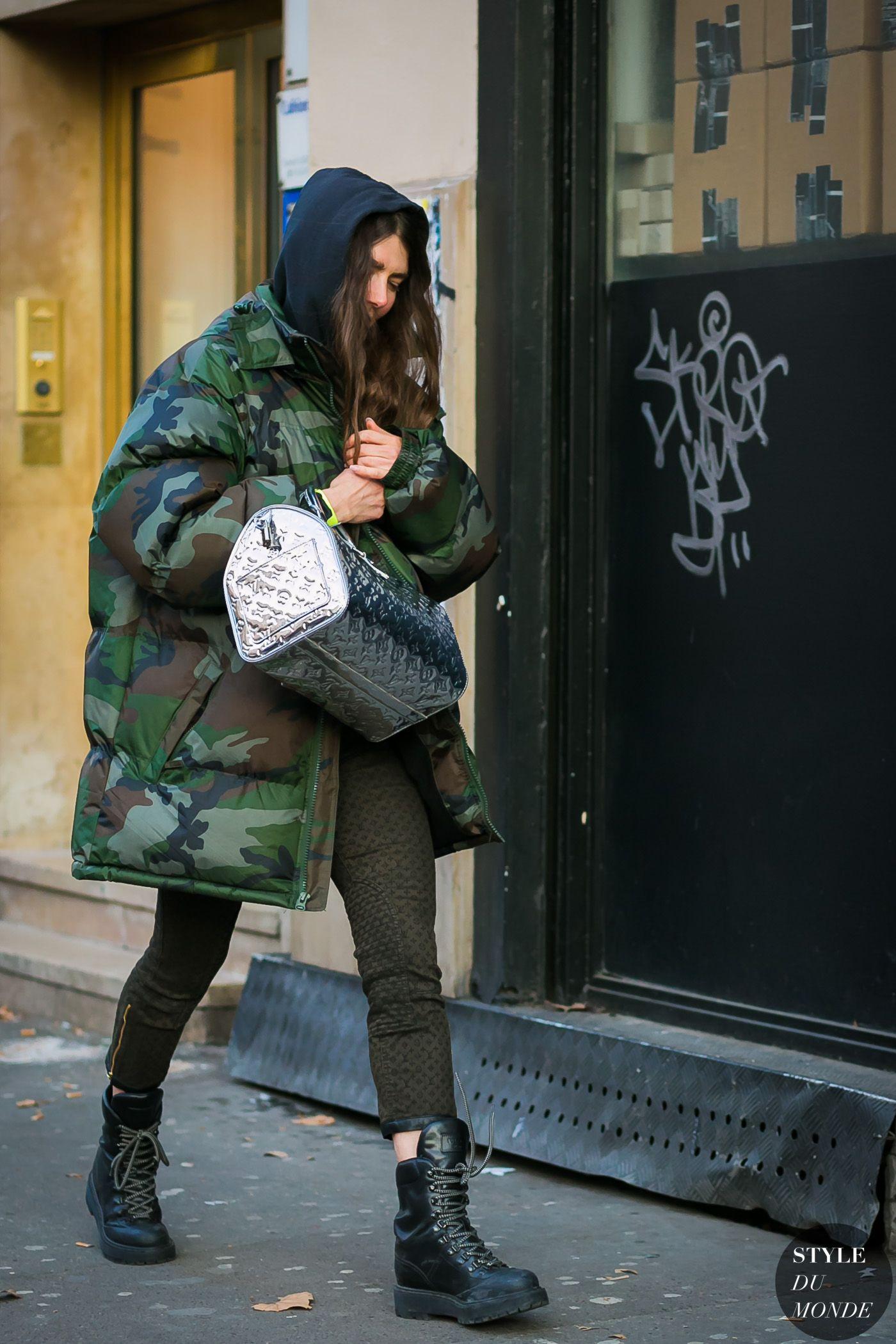 9f0dd97c3b2 black hoodie + camo oversized puffer jacket + silver LV purse + olive pants  + black combat boots