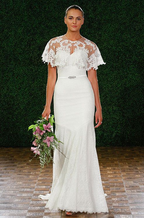 A simple strapless wedding dress with an illusion lace cover-up ...