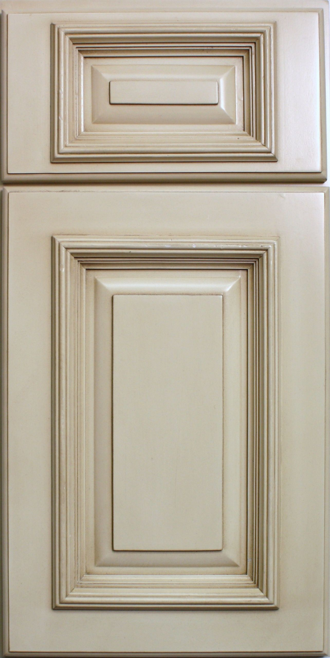 Antique white kitchen cabinets with chocolate glaze for Kitchen cabinet door colors