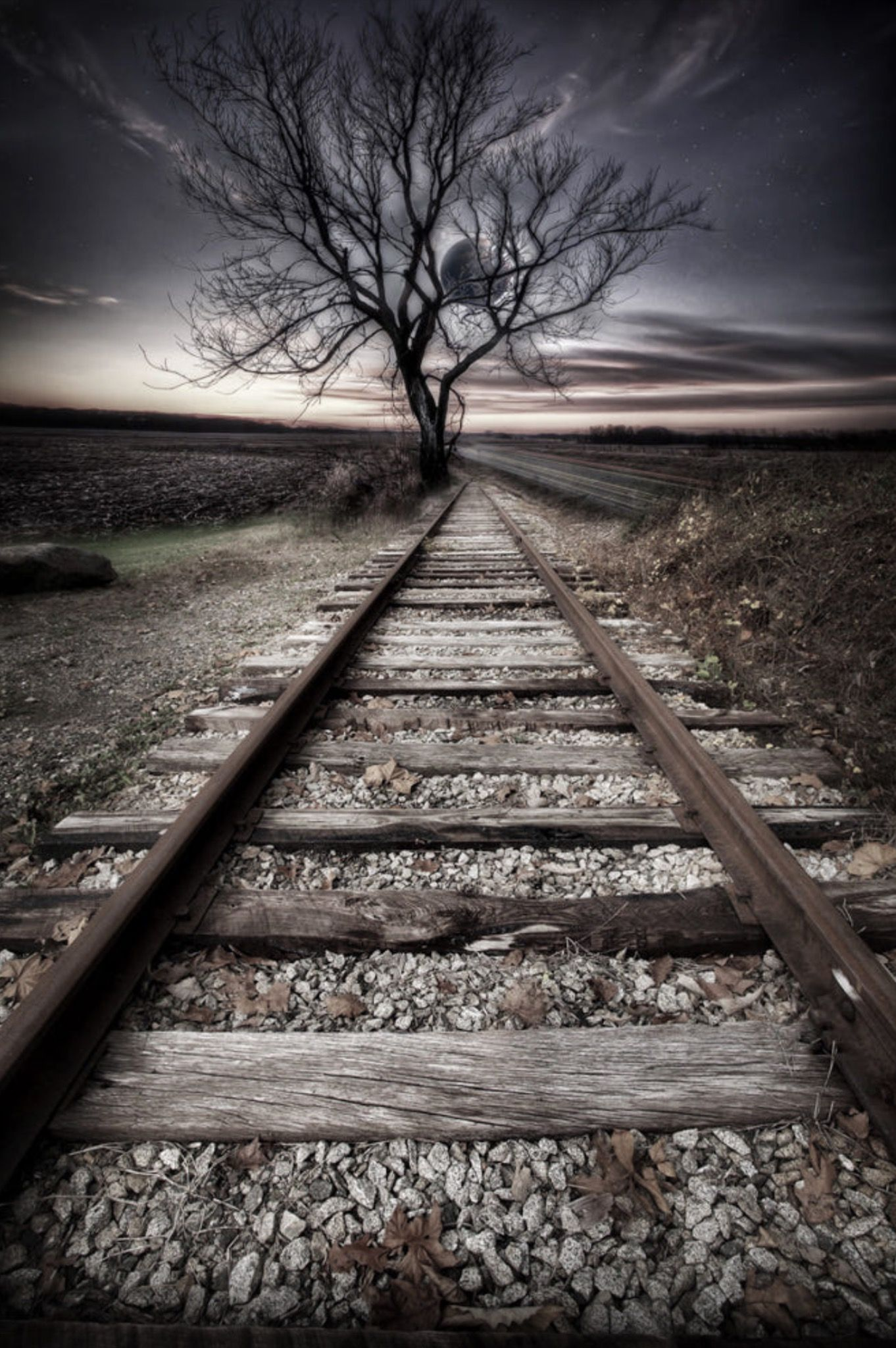 traintrackeclipse. Photo by Todd Wall. Source 500px.com