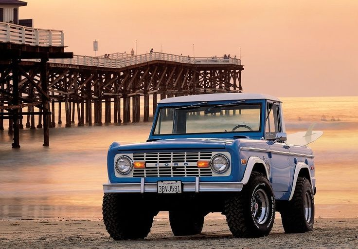 Baby Blue 1976 Ford Bronco On The Beach Near The Pier With Surfboard Under Beautiful Glowing Skies Our 5000th Article Ford Bronco Bronco Ford Trucks