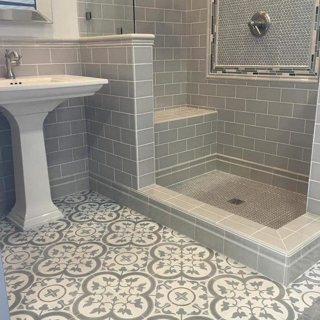 Modern hexagon and subway tile shower with a muted spanish for Modern subway tile bathroom designs