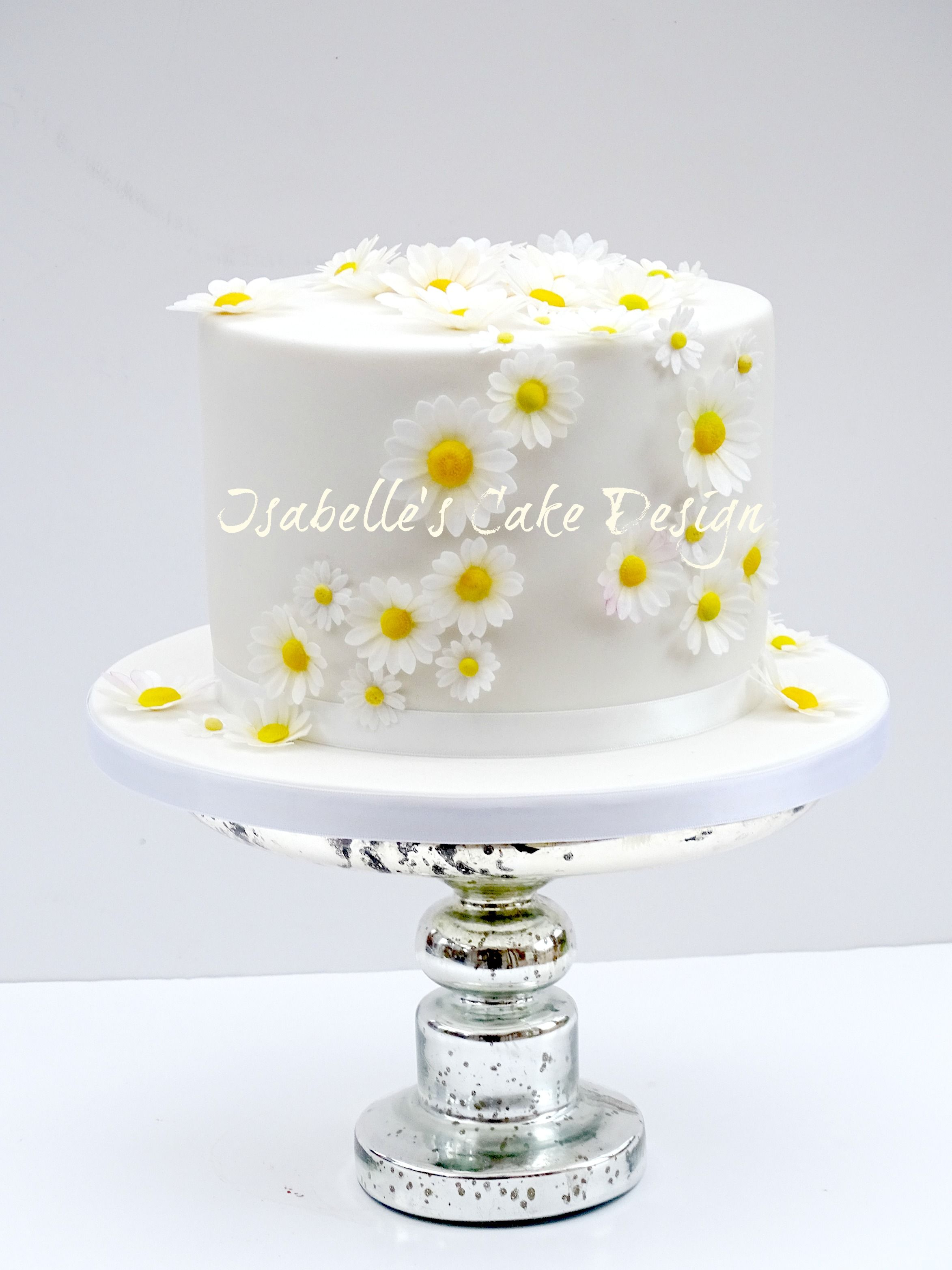 A single tall tier simple wedding cake, iced in white fondant and ...