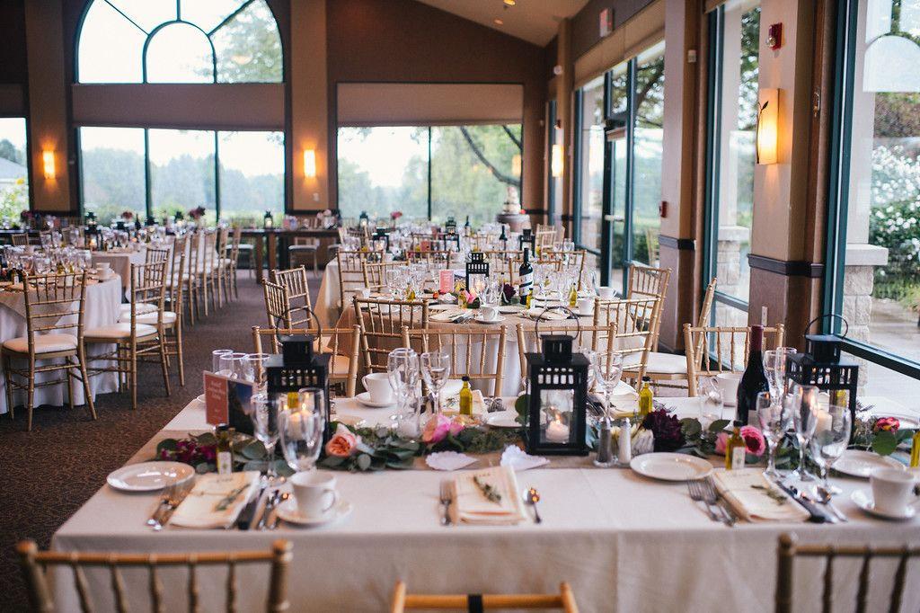 impeccable. gold chiavari chairs, burlap, lanterns, beautiful blooms, and greenery.