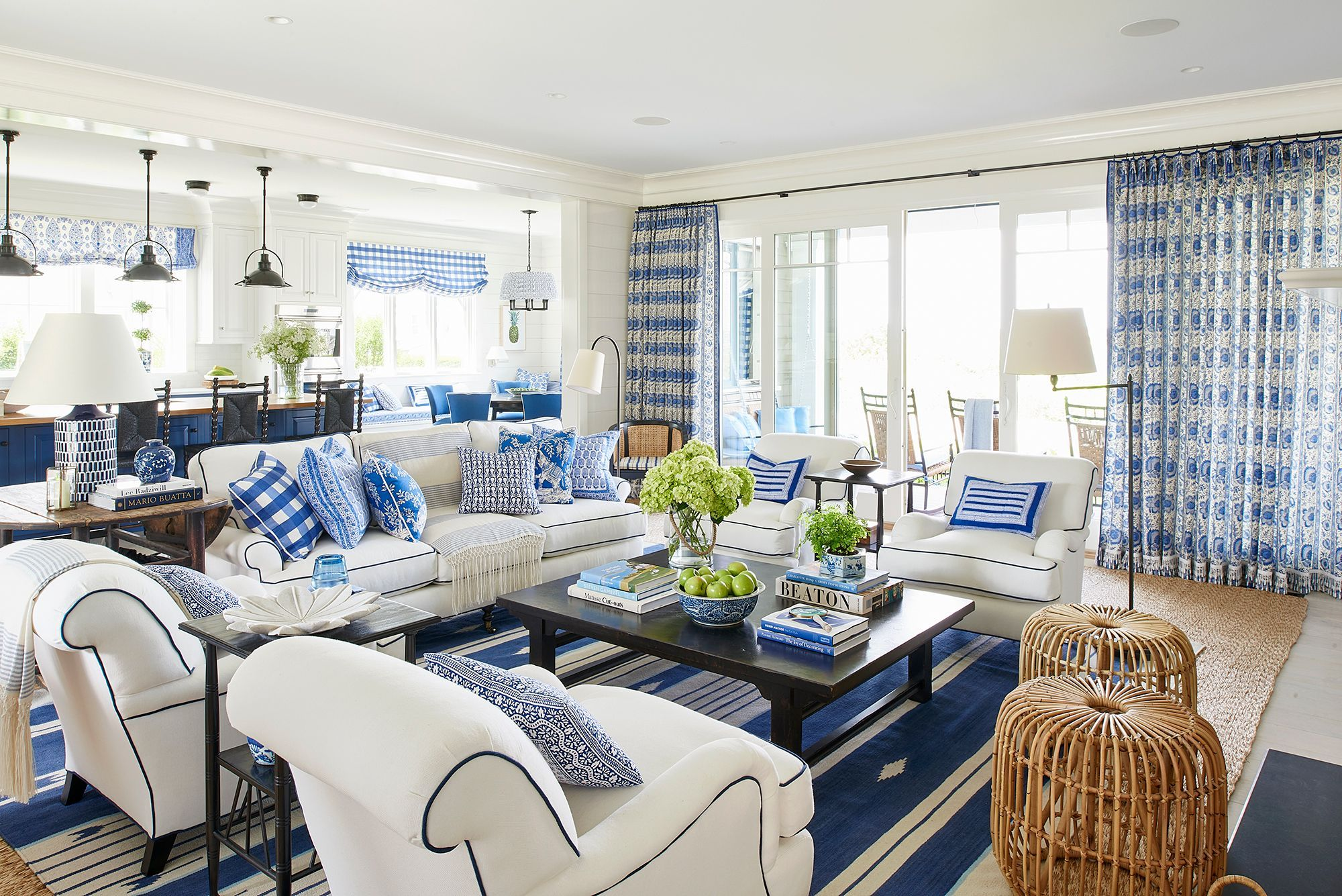 White Furniture With Dark Blue Striped Dhurrie And Patterned Pillows