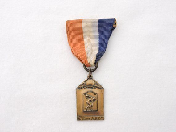 track medal blue and white pin ribbon