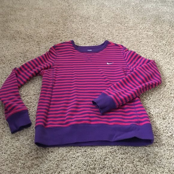 Nike Long Sleeve Long sleeve Nike shirt. 96% cotton 4% spandex. Size L but fits more like a M. Nike Tops Sweatshirts & Hoodies