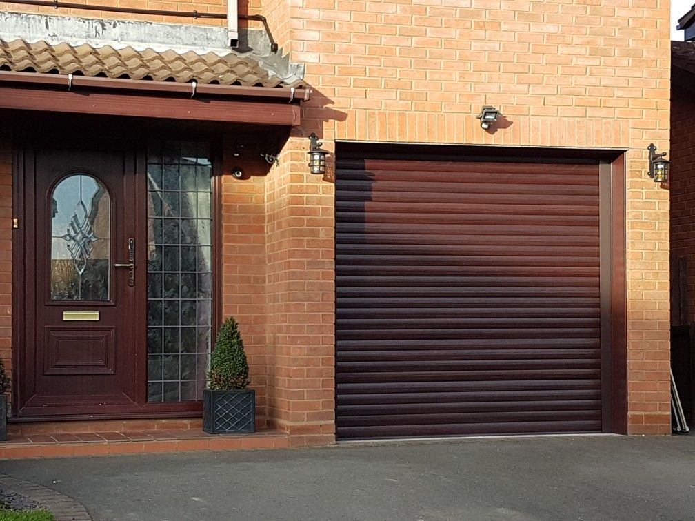 Rosewood finish insulated remote control garage roller shutter door fitted in dudley west midlands .worcesterdoors.co.uk | roller shutter doors ... & Rosewood finish insulated remote control garage roller shutter door ...