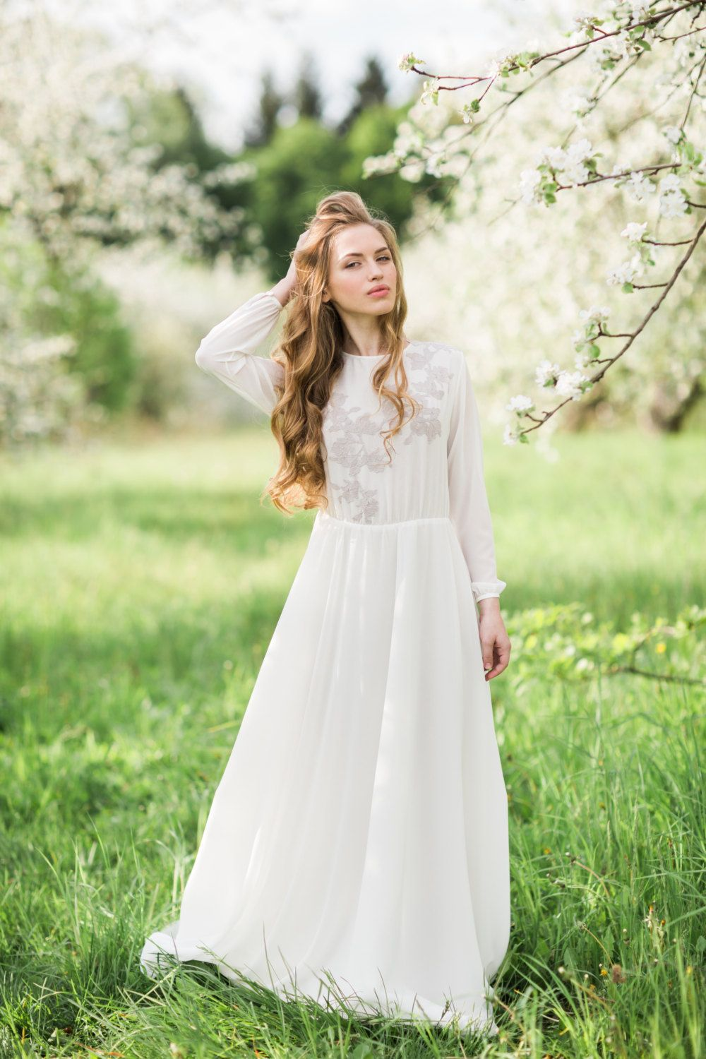 Offwhite long sleeve wedding dress with lavender lace appliques