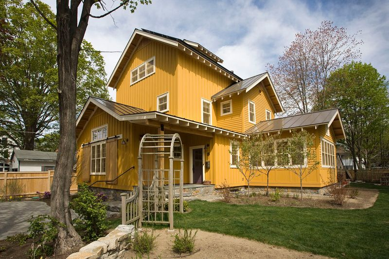 Natural cedar siding with solid body stain to give it the mustard color window trim is solid for Best exterior stain for cedar siding