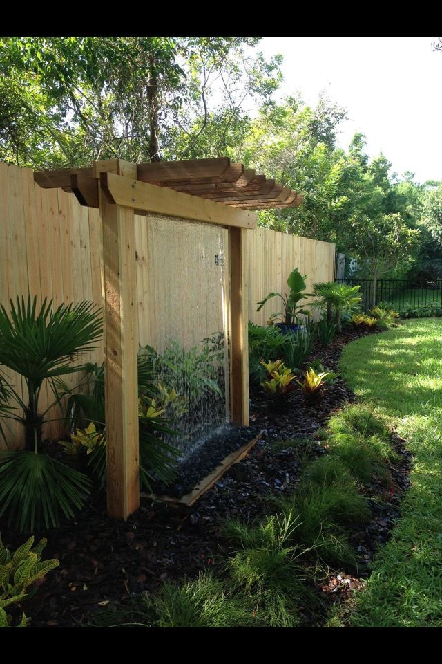 Custom built pergola with a rain curtain water feature for Diy small garden water features