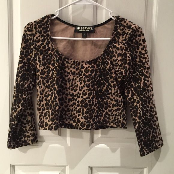 lip service genuine punk leopard crop top size L lip service genuine punk leopard crop top size L, never been worn. Tag is gone. Super cute. 3/4 sleeve. Comes from a smoke free home. If you have questions or concerns please leave a message! Urban Outfitters Tops Crop Tops