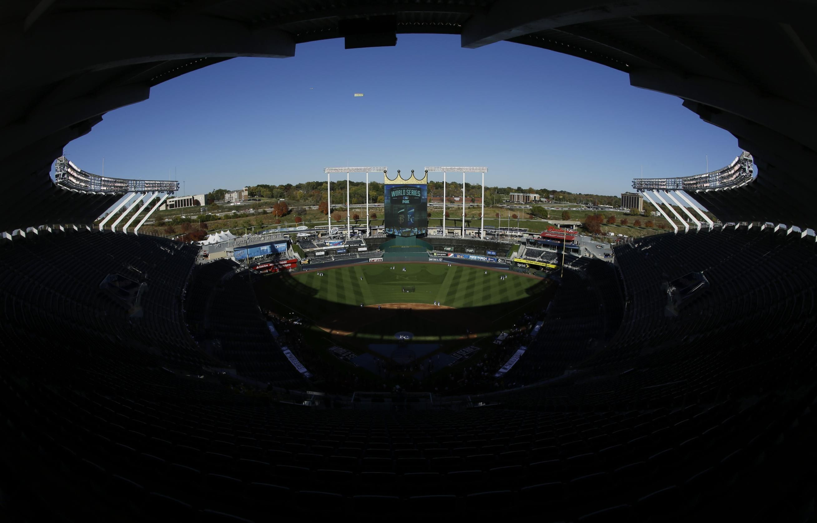 Kansas City Royals warm up in Kauffman Stadium before Game 1 of baseball's World Series against the San Francisco Giants Tuesday, Oct. 21, 2014, in Kansas City, Mo. (AP Photo/Jeff Roberson)