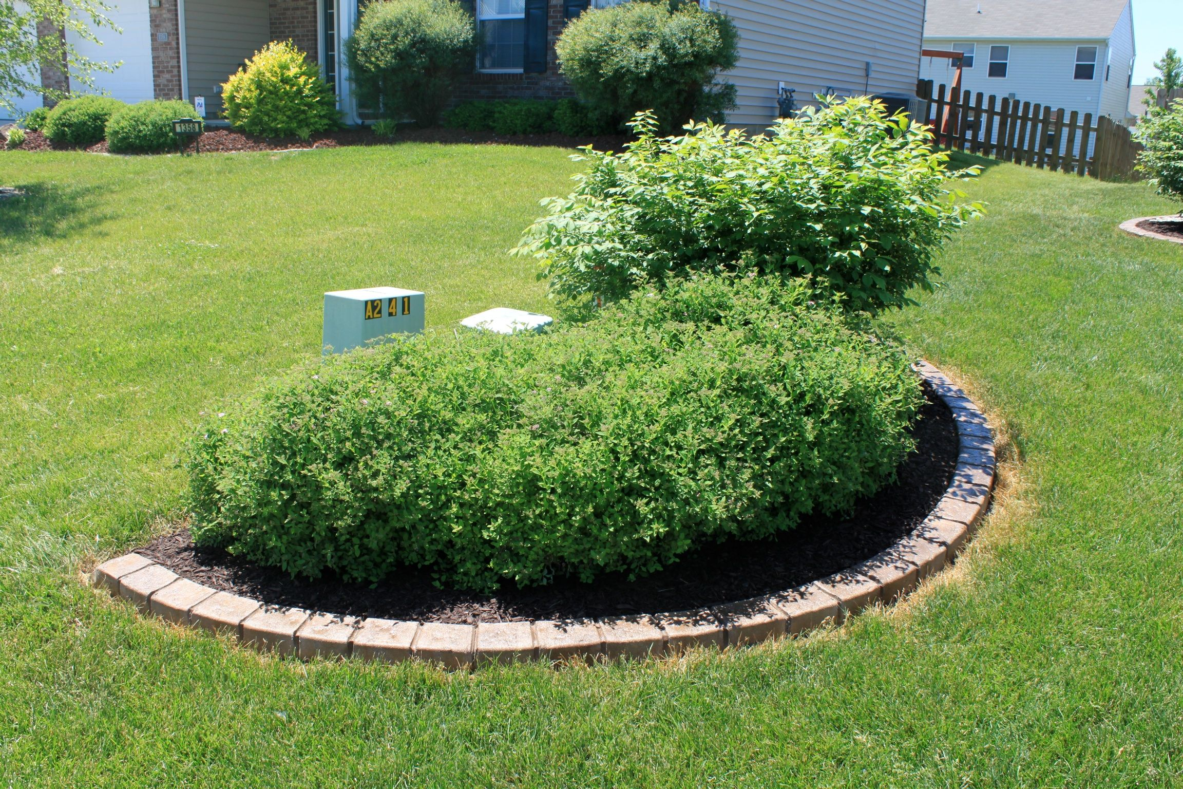Landscaping to cover utility boxes our landscaping for Landscape rock utility cover