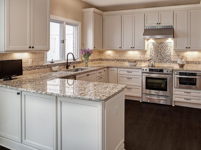 White Cabinets, Dark Wood Floors, Napoli Granite, Behr Wheat Bread Walls
