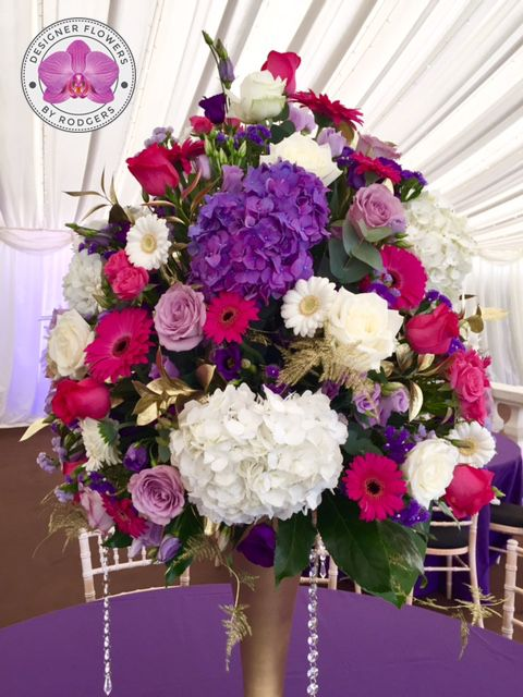 Table Centre Pieces   Designed On Tall Gold Trumpet Vases Sat On Mirrors.  White Avalanche Roses, Deep Purple And Lilac Lisianthus, White And Purple  ...
