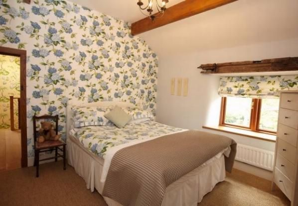 Matching floral print in this cosy cottage