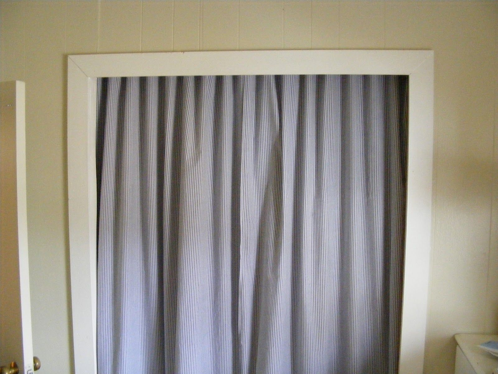 Curtains Hung Inside The Closet Door. Totally Doing This For The Laundry  Closet.