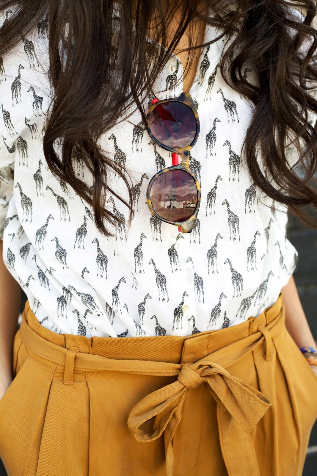 this shirt is so cute! in love with the giraffe print- perfect for mixing patterns.