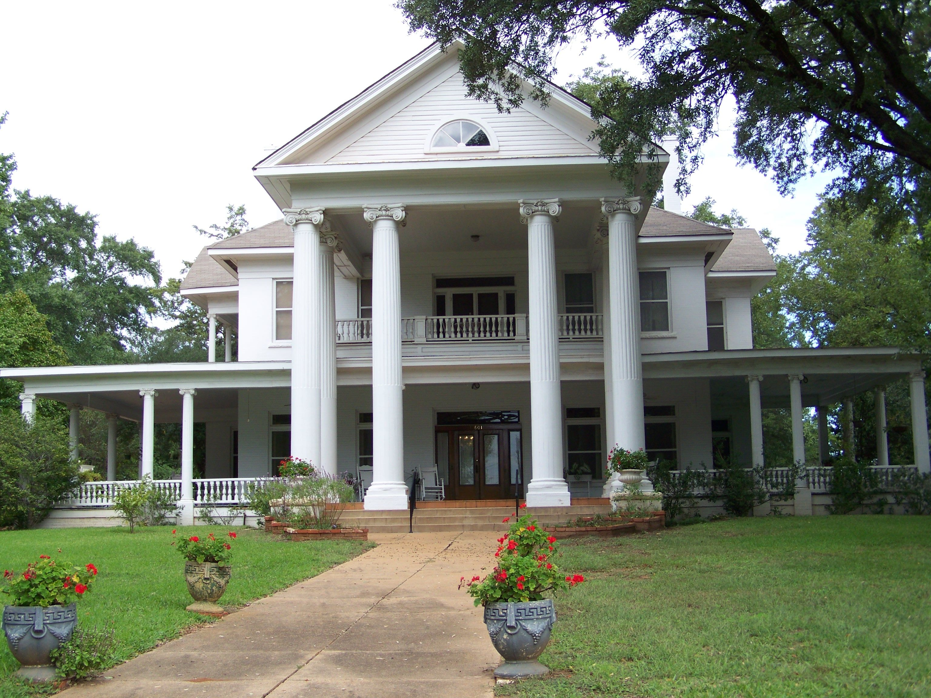 Gorgeous White Greek Revival Mansion With Huge Columns Across The Front And A Wrap Around Porch Located In Palest House With Porch Farmhouse Plans House Plans