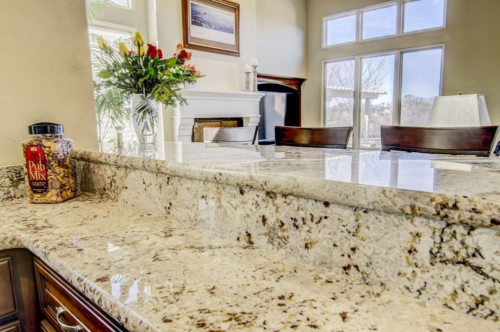Snowfall Granite Raised Bar Granite Backsplash Kitchen Remodel