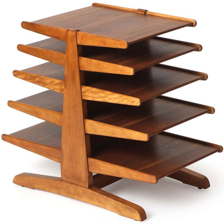 Magazine Tree By Edward Wormley - A finely detailed and sculptural periodicals stand in walnut having five cantilevered shelves that symmetrically descend in scale from bottom to top.